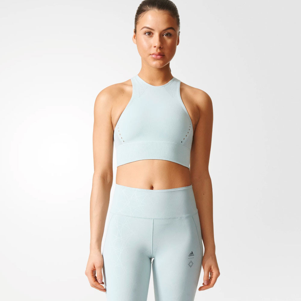 ebf9496c1fe Rounding off the crop top is laser cut adidas and Wanderlust branding below  the back of the neck for a sleek, fashionable look.