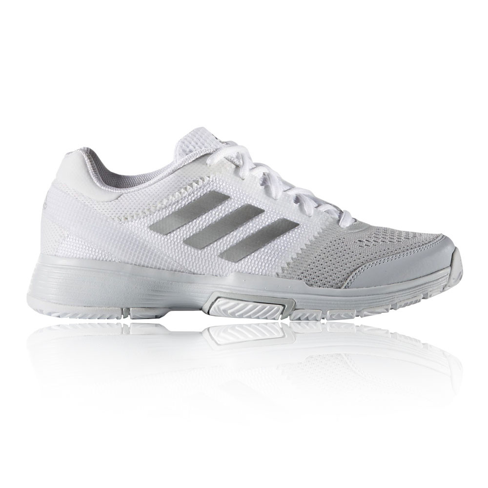 Women's tennis shoes are designed to handle the unique rigors of your tennis game. Unlike running shoes, which are made for repetitive forward motion, tennis shoes best handle quick, lateral footwork.